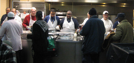 Knights of Columbus join St. John Hospice staff to serve up Thanksgiving dinner.