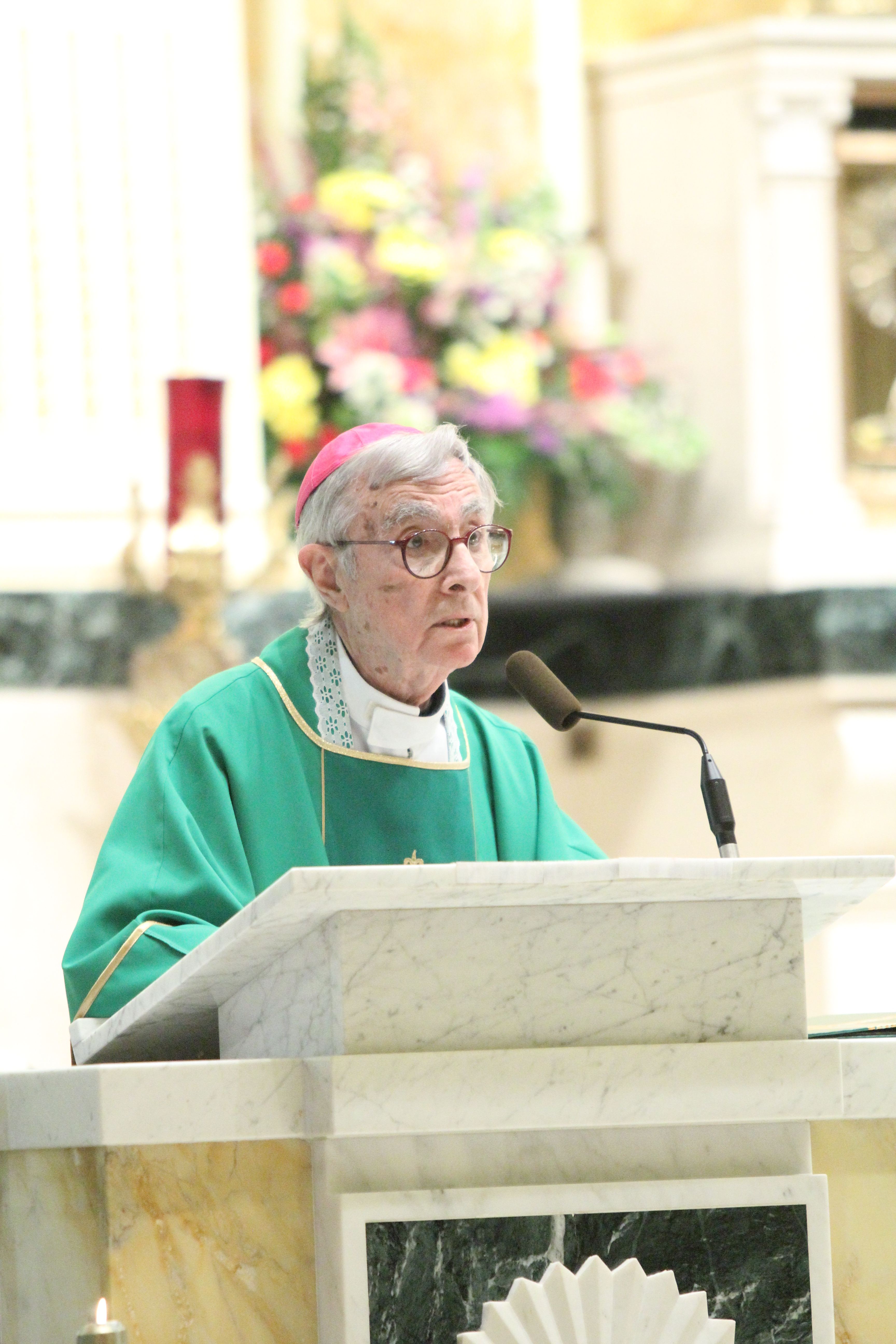 Retired Auxiliary Bishop Louis DeSimone gives the homily during a Mass at St. Monica Church Feb. 18. Bishop DeSimone was celebrating his 90th birthday at the parish where he served as pastor for 25 years.