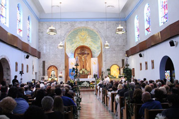 Members of St. Nicholas of Tolentine Parish celebrate 100 years in South Philadelphia with an April 29 Mass in the church. Retired Auxiliary Bishop Louis DeSimone and Auxiliary Bishop Michael Fitzgerald concelebrated the Mass.