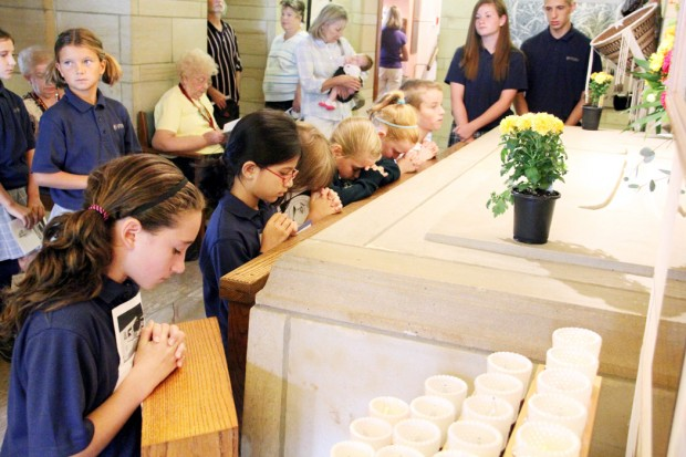After Mass at the St. Katharine Drexel Shrine, students of St. Katharine Regional School in Holland pray at the tomb of their school's patron saint.  (Sarah Webb)