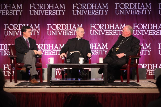 Political satirist Stephen Colbert, Jesuit Father James Martin, moderator, and New York Cardinal Timothy M. Dolan are seen during a conversation about humor, faith, joy and the spiritual life Sept. 14, 2012, at Fordham University in the Bronx section of New York. (CNS photo/Bruce Gilbert, courtesy Fordham University)