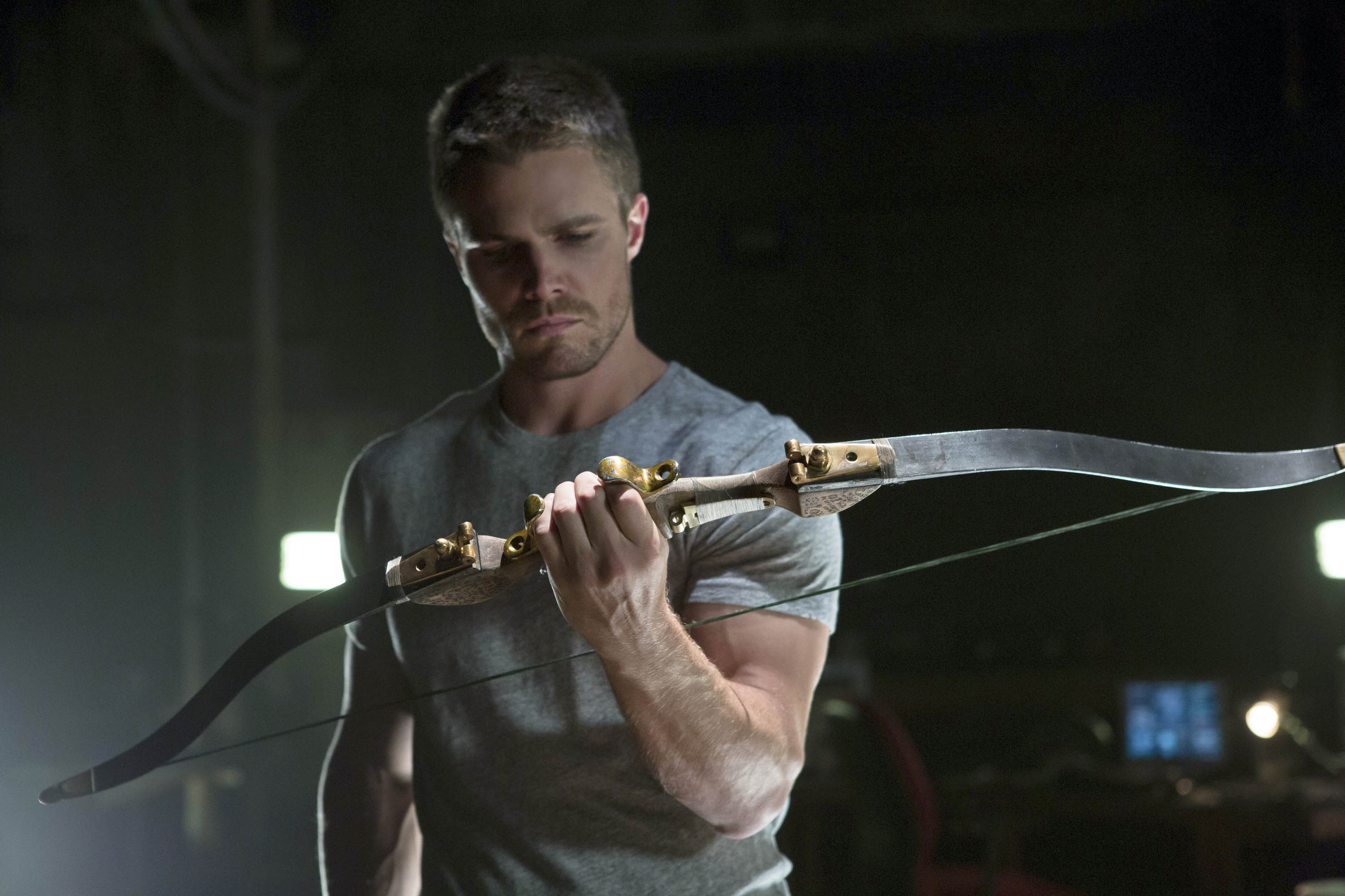 "Stephen Amell stars as Oliver Queen in an episode of the CW series ""Arrow."" (CNS photo/Jack Rowand, The CW)"