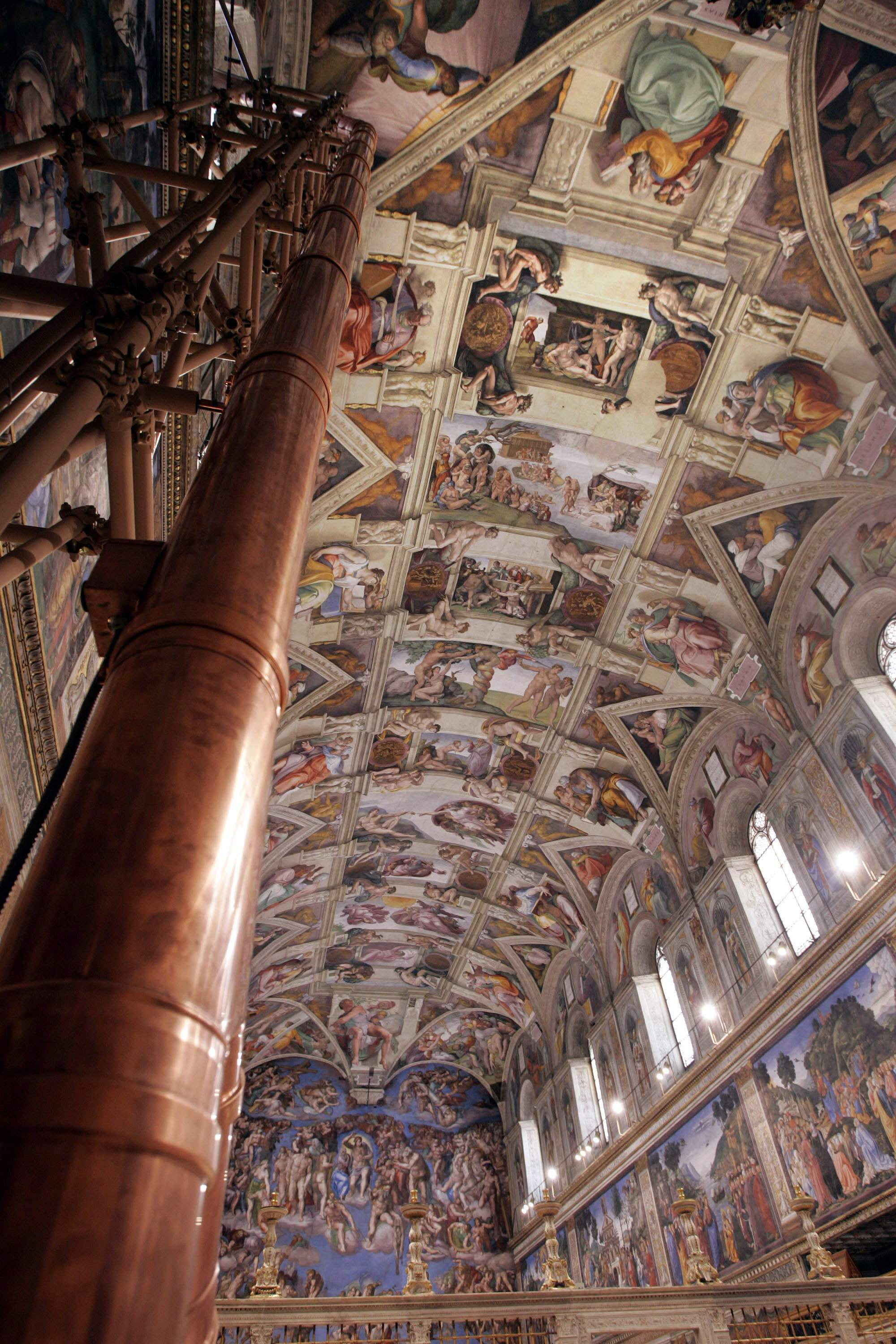 Conclave stovepipe, Michelangelo's frescoes seen in 2005 file photo of Sistine Chapel