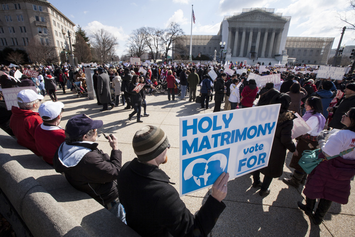 Kyle Kaniper, a Catholic from Salisbury, Md., holds up a sign supporting traditional marriage outside the Supreme Court building in Washington (CNS photo/Nancy Phelan Wiechec)