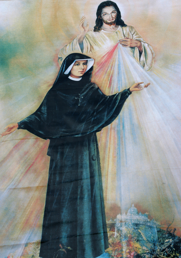 Polish Sister St. Faustina Kowalska is depicted with an image of Jesus Christ the Divine Mercy. Sauk Centre, Minn., is celebrating 31 years of being dedicated to the Divine Mercy, which came about through the efforts of four Catholic men who live in the community. (CNS photo/Nancy Wiechec)