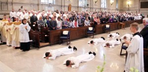 During ordination the six men lay prostrate during the litany of saints.