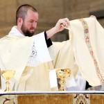 Newly ordained Deacon Robert Gross serves as Deacon of the Eucharist during his ordination Mass.