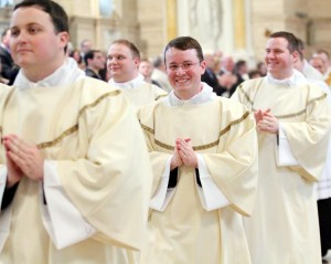 Deacons Sean English, Christopher Moriconi and David Waters Jr. joyfully recess from Mass after their ordination.