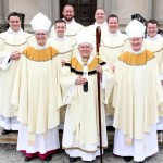 Newly ordained deacons (top, from left) Robert Gross, Charles Ravert,