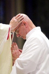 Anthony Cincotta prays as he is ordained a deacon by the laying of hands by Archbishop Chaput.