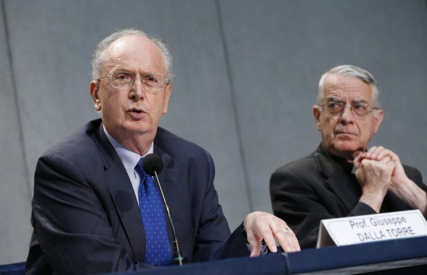 Giuseppe Dalla Torre, presiding judge of the Vatican City State court, speaks during a July 11 Vatican news conference concerning Pope Francis' motu proprio on criminal law matters. Also pictured is Jesuit Father Federico Lombardi, the Vatican spokesman.  (CNS photo/Paul Haring)