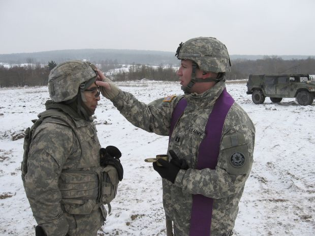 Army chaplain Father Christopher Butera administers ashes to soldiers training in the field on Ash Wednesday earlier this year. (CNS photo/courtesy of Father Butera)