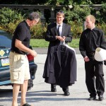 Eugene Bonacci helps his son, Alec, move in for his first year at Saint Charles Seminary with the help of fellow seminarian Brain Burman.