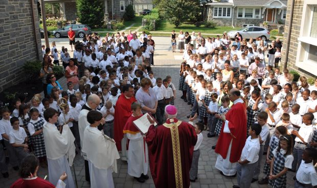 Bishop Daniel Thomas leads the blessing rite for students and staff of St. Andrew School, Drexel Hill, as he dedicates the primary building the Father Joseph McShain Building on Sept. 11.