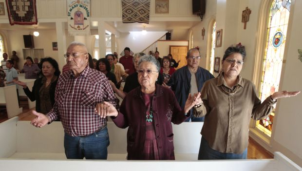 People pray during Mass in 2011 at St. Mary Church in Tohatchi, N.M., on the Navajo Indian Reservation in Diocese of Gallup.  (CNS photo/Bob Roller)