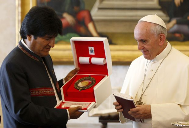 Pope Francis exchanges gift with Bolivian President Evo Morales during a private audience at the Vatican Sept. 6. (CNS photo/Riccardo De Luca, ...