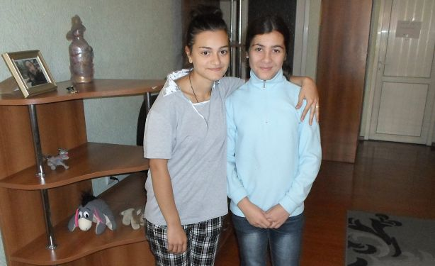Darina Eradze, 17, and Natia, 12, pictured in an Oct. 5 photo, are among the 50 Georgian girls and boys without parents who live in Caritas-run family-oriented homes in the country's capital, Tbilisi. (CNS photo/James Martone)