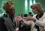 Connie Hedegaard, European commissioner for climate action, right, talks with Kenyan delegate Alice Akinyi Kaudia as they attend the Conference of Parties of the U.N. Framework Convention in Warsaw, Poland, Nov. 19.  (CNS photo/Kacper Pempel, Reuters)