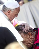 Pope Francis embraces Vinicio Riva, 53, during his general audience in St. Peter's Square at the Vatican Nov. 6. Riva, who is afflicted with neurofibromatosis, said receiving the pope's embrace was like being in paradise. Riva is from a small village near Vicenza in northern Italy. (CNS photo/Claudio Peri, EPA)