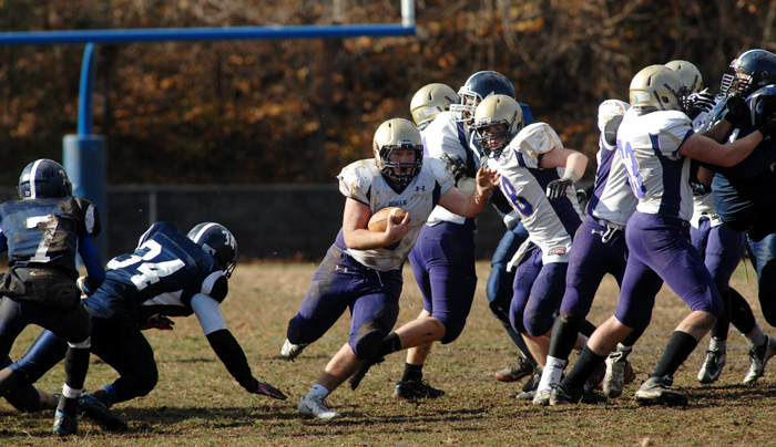 Roman Catholic running back Patrick McCourt enjoys carrying the ball through a big hole opened up by his offensive line during Roman's Thanksgiving Day win over traditional rival Roxborough High. (D'Mont Reese)