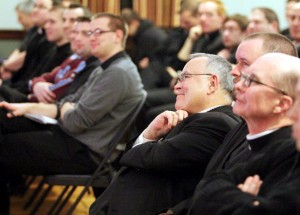 Archbishop Charles Chaput (center) and St. Charles Seminary rector Bishop Timothy Senior (right) enjoy the Cardinal Foley lecture given by Oblate Father Thomas Dailey, who holds the chair named for the cardinal at the seminary. (Photos by Sarah Webb)