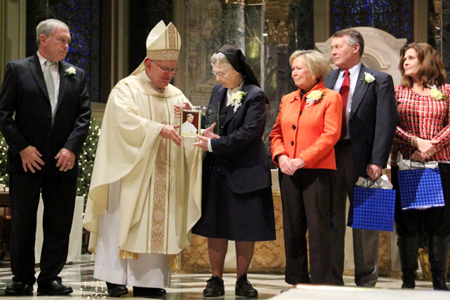 Sister Jane McFadden, I.H.M., along with family members receives the Paul VI Award given posthumously to her brother, Bishop Joseph McFadden, by Archbishop Chaput. (Sarah Webb)