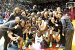 The Neumann Goretti girls celebrate their Catholic League basketball championship victory over Archbishop Wood Monday night at the Palestra. (Sarah Webb)