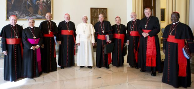 Pope Francis poses with cardinal advisers during a meeting at the Vatican. (CNS photo/L'Osservatore Romano via Reuters)