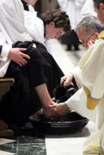 The archbishop washes the feet of the seminarians.