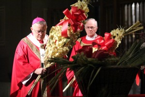 Archbishop Chaput and Msgr. Arthur Rodgers, rector of the cathedral, carry their palms.