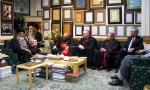 U.S. Cardinal Theodore E. McCarrick, retired archbishop of Washington, Bishop Richard E. Pates of Des Moines, Iowa, and Baltimore Auxiliary Bishop Denis. J. Madden meet with Seyyed Mahmoud, left, at the Ayatollah Marashi Najafi Library in Qom, Iran, in March. At right is Stephen Colecchi, director of the U.S. bishops ' office of International Justice and Peace. (CNS photo/courtesy Stephen M. Colecchi)
