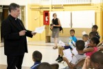 Msgr. Daniel Sullivan, board chairman of NDS, leads the children in a peace prayer June 18 at St. Athanasius School in Philadelphia.