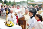 The archbishop incenses the monstrance during the first stop of the procession.