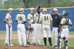 Neumann-Goretti coach Kevin Schneider talks pitching strategy with junior lefthander Pat Doudican (31), along with his other infielders. (Sarah Webb)