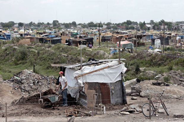 A man walks next to his makeshift home in 2008 in Buenos Aires, Argentina. Lawyers for Argentina have asked the U.S. Supreme Court to hear its appeal in a lawsuit that could affect how the country is able to fund development and human services programs or pay off massive loans that were purchased by a U.S. hedge fund. (CNS photo/Cezaro De Luca, EPA)