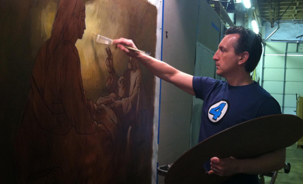 Neilson Carlin of Kennett Square works on a scene depicting the life of the Holy Family in a commission for Sacred Heart Parish, Royersford.