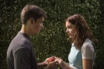 "Brenton Thwaites and Odeya Rush star in a scene from the movie ""The Giver."" (CNS photo/courtesy The Weinstein Company)"
