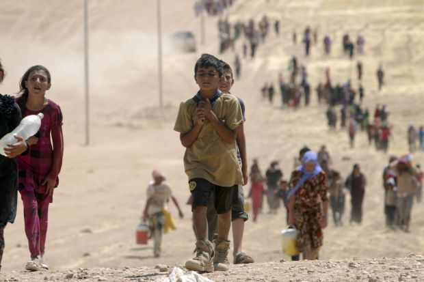 Children flee violence from forces loyal to the Islamic State in Sinjar, Iraq, Aug. 10. (CNS photo/Rodi Said, Reuters)