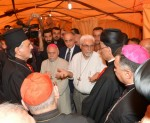 Syriac Catholic Patriarch Ignace Joseph III Younan, left, speaks to other Christian leaders during an Aug. 20 visit to Iraqi refugees in Irbil, Iraq. (CNS photo/Mychel Akl, courtesy Maronite Patriarchate)