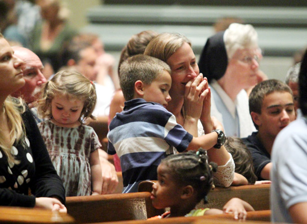 Families pray at the Cathedral Basilica of SS. Peter and Paul last year -- and they will have ample opportunity to do so during the World Meeting of Families this September. (File photo by Sarah Webb)