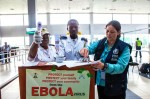 Dr. Aileen Marty, a Miami-based infectious disease expert, stops at a checkpoint in the Lagos International Airport in Nigeria. (CNS photo/courtesy Florida International University)