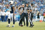 Bryan Neale, center, talks with a fellow NFL official during a pre-season game in early August between the San Diego Chargers and the Dallas Cowboys. (CNS photo/courtesy Bryan Neale)