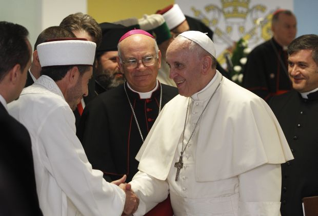 Pope Francis greets a Muslim representative during a meeting with leaders of other religions at the Catholic University of Our Lady of Good Counsel in Tirana, Albania, Sept. 21. (CNS photo/Paul Haring)