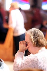 Laura Volpe prays during Mass.