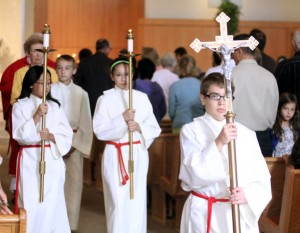 Leading the procession out of church at the conclusion of Mass are, from left, altar servers Emily Mirabelli, Brady McCormick, Daniela Guerra-Solano and Liam Burns.