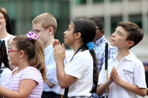 students from St. Lucy and Archbishop Ryan School for the Deaf perform.