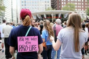 Lara Miller (left) and Meghan Dietzler attend the rally from St. Joseph's University.