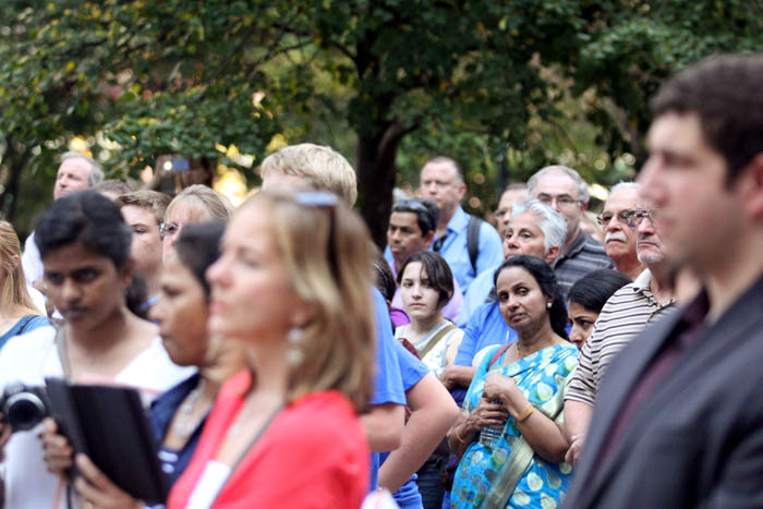 People participating in the rally at Love Park in center city listen to a speaker.