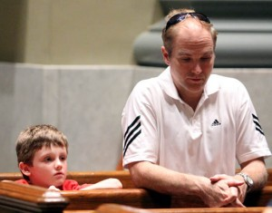 William Brothers prays along with his father David from St Lawrence in Upper Darby, after the walk.