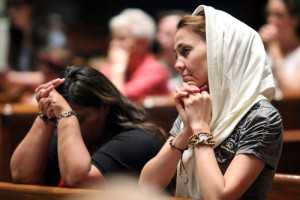 Holly Wright from NYC prays during holy hour before mass.